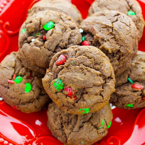 Red holiday plate with chocoalte cookies with red and green m&ms