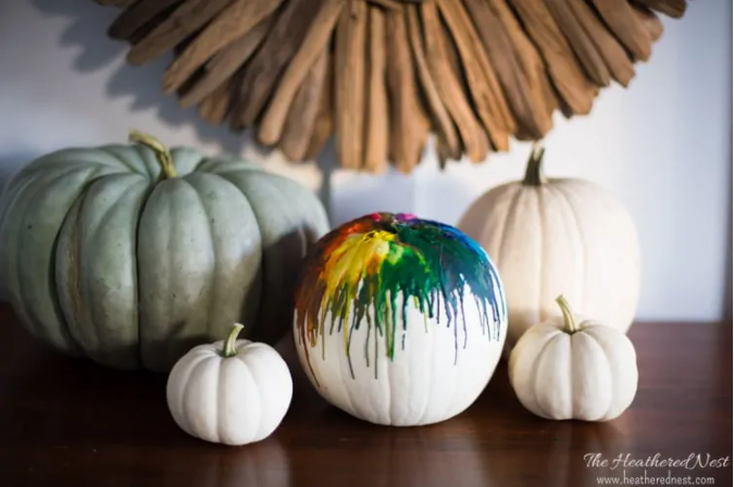 white pumkin with melted crayons dripped down