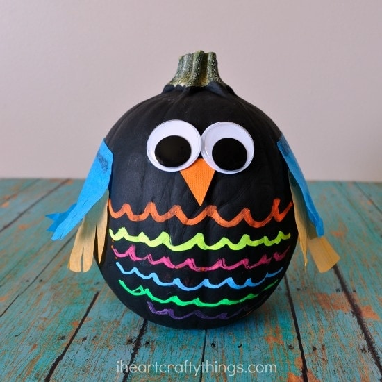 A pumpkin painted and accents added to resemble an owl