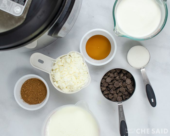 Instant Pot Tuxedo Hot Chocolate ingredients in small bowls and measuring cups