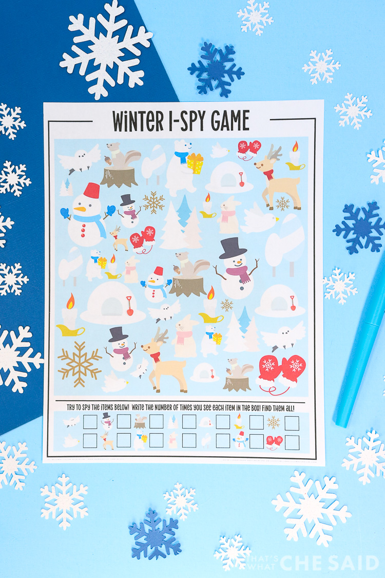 Blue background with snowflakes and the printed printable wiith a blue pen in vertical format.