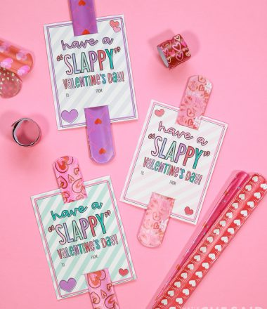 pink background with slap bracelets and printable valentines