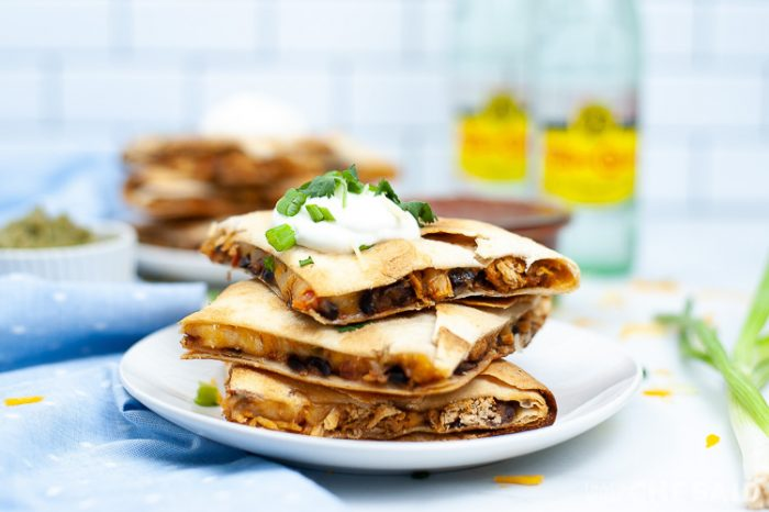 Sheet Pan Chicken Quesadillas cut and stacked on a plate