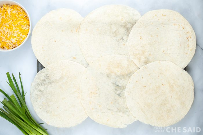 6 tortillas laid out on a sheetpan