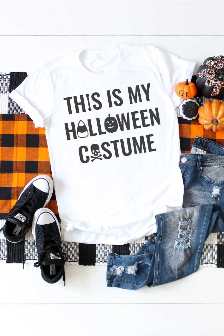 White shirt on plaid runner with jeans and t-shirt and Halloween saying on T-shirt