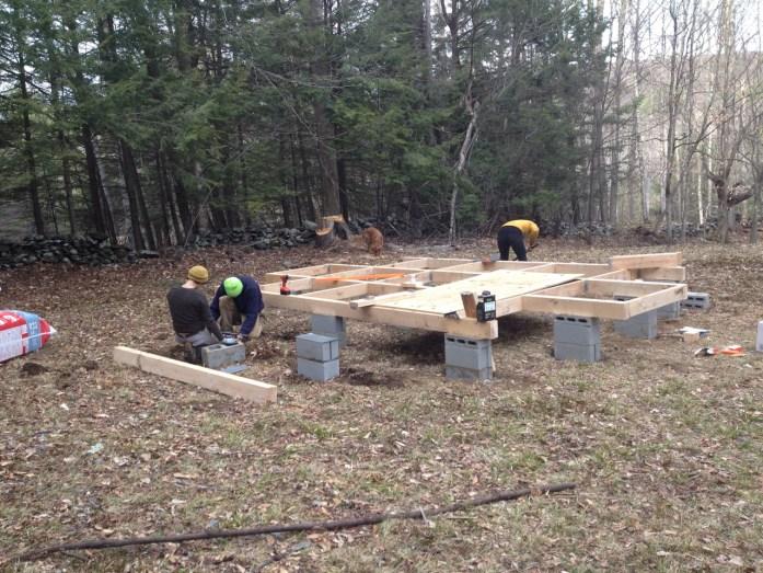 building the yurt platform, leveling the cinder block foundation