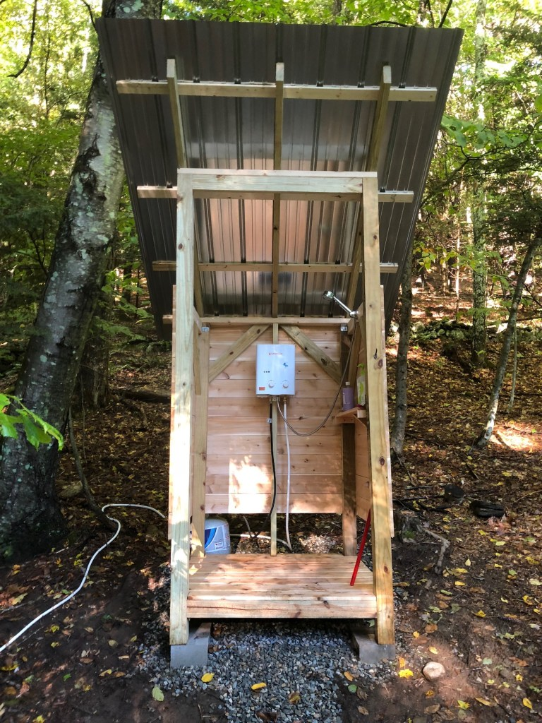 Front view of off grid propane heated shower