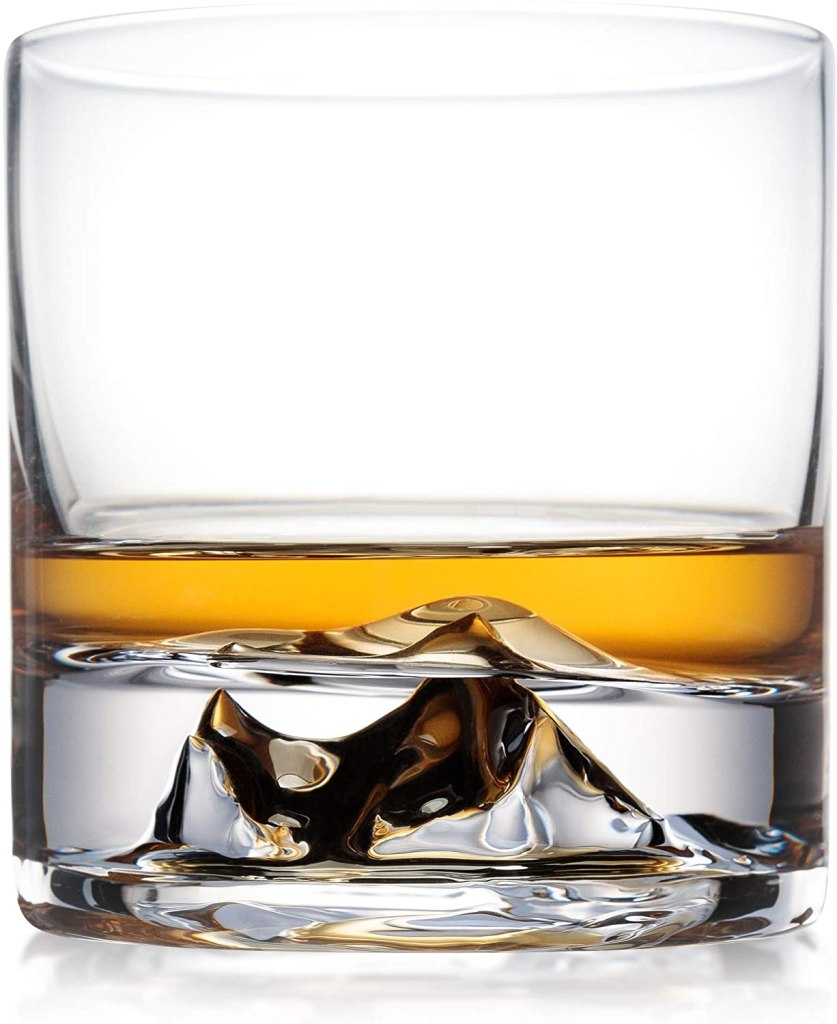 Glass whiskey tumbler featuring raised topographical impression of Mount Everest, handblown by 63Above