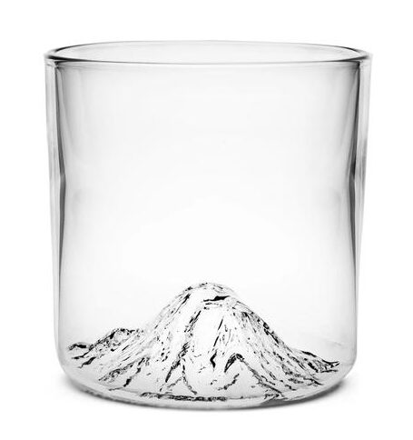 Glass whiskey tumbler with mountain impression in bottom made by North Drinkware