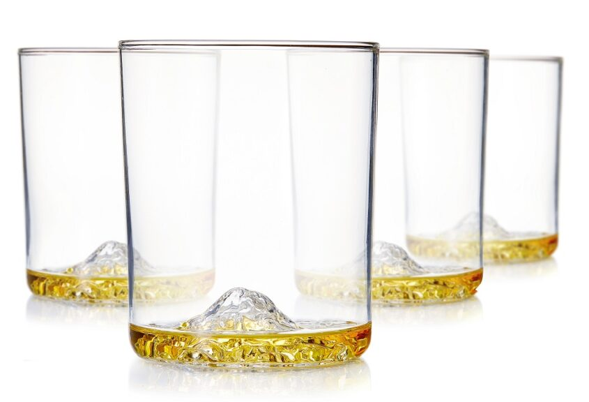 Set of four glass whiskey tumblers with mountain impressions in the bottom made for Huckberry