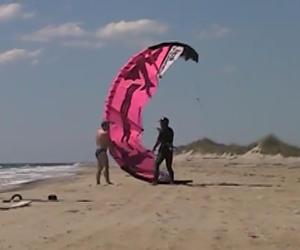 swim brief help launch kite surfer