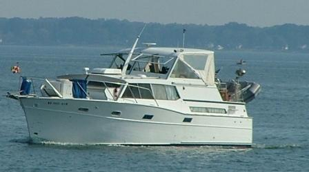 This cabin cruiser makes its way down the Potomac.  THE CHESAPEAKE