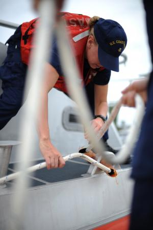 Petty Officer 2nd Class Amanda Christensen, a boatswain mate at Coast Guard Station Cape Charles, Va., handles lines while mooring the station's new 45-foot Response Boat - Medium at the pier, Friday, Aug. 24, 2012. The station's RB-M is the 100th boat of 166 being delivered to the Coast Guard to replace the aging 41-foot Utility Boat fleet. U.S. Coast Guard photo by Petty Officer 3rd Class David Weydert