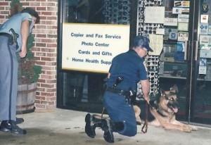 Burglars hit St. John's Pharmacy. K-9 Tarras and Dep. Phil Joseph, Dep. William Bell