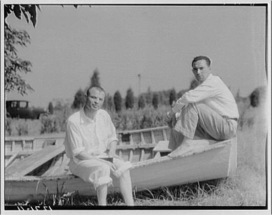 Acclaimed photographer of Washington, D.C. and environs Theodor Horydzak and friend sitting on boat.