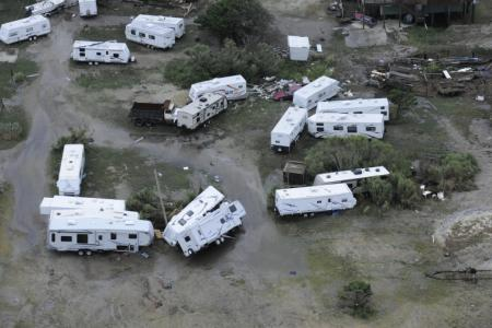 Trailers damaged by Hurricane Arthur on the Outer Banks of North Carolina, July 4, 2014, are viewed from a Coast Guard MH-60 Jayhawk helicopter from Air Station Elizabeth City. The Coast Guard is in the process of assessing damage in the wake of Hurricane Arthur. (U.S. Coast Guard photo by Petty Officer 3rd Class David Weydert)