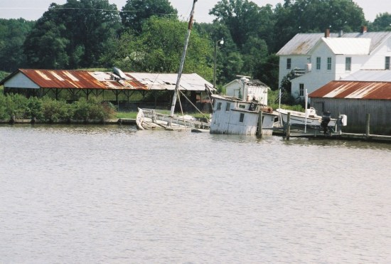 Buyboat's last days in final resting place on Nomini River, Virginia. THE CHESAPEAKE TODAY photo