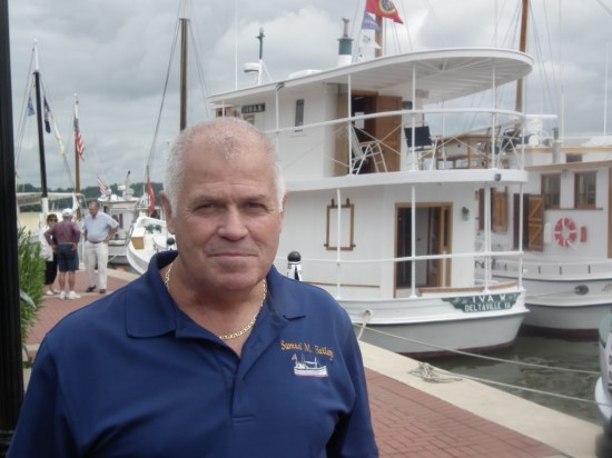Sam Bailey, the grandson of the man for whom the Samuel M. Bailey was named, visited the assembly of famous Chesapeake Bay Oyster Buyboats. Bailey noted that his brother's boat, the Samuel M. Bailey, is the youngest of those buyboats in the flotilla. It was built in 1957. THE CHESAPEAKE TODAY photo