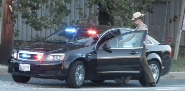 Maryland State Trooper on traffic stop in unmarked unit as police seek killers. THE CHESAPEAKE TODAY photo