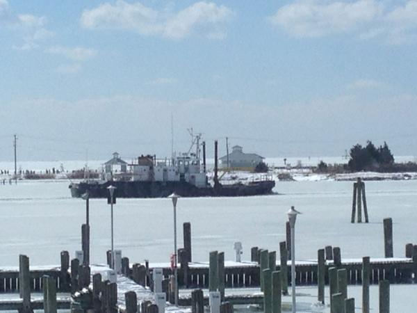 The Maryland Natural Resources cutter Tawes working at cutting a channel in Crisfield, Md. in the Somers Cove Marina harbor.