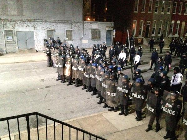 Baltimore Police face off with thugs breaking windows and damaging police cars