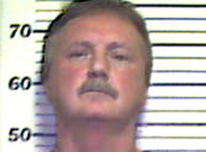 Gary A. Greenwood police photo taken after his arrest on charges of threatening a person with a handgun. The gun was later found at his business and he was identified from a photo lineup.