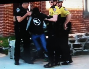 Freddie Gray being handcuffed by Baltimore Police