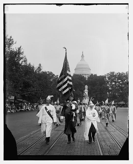 Klan on the march 1926 used the U.S. flag in this parade on Pennsylvania Ave. near the U. S. Capitol.