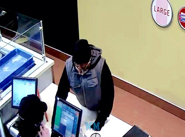 Have you seen this hat on an armed robber - Does Domino's really care if gunmen show up in their stores?