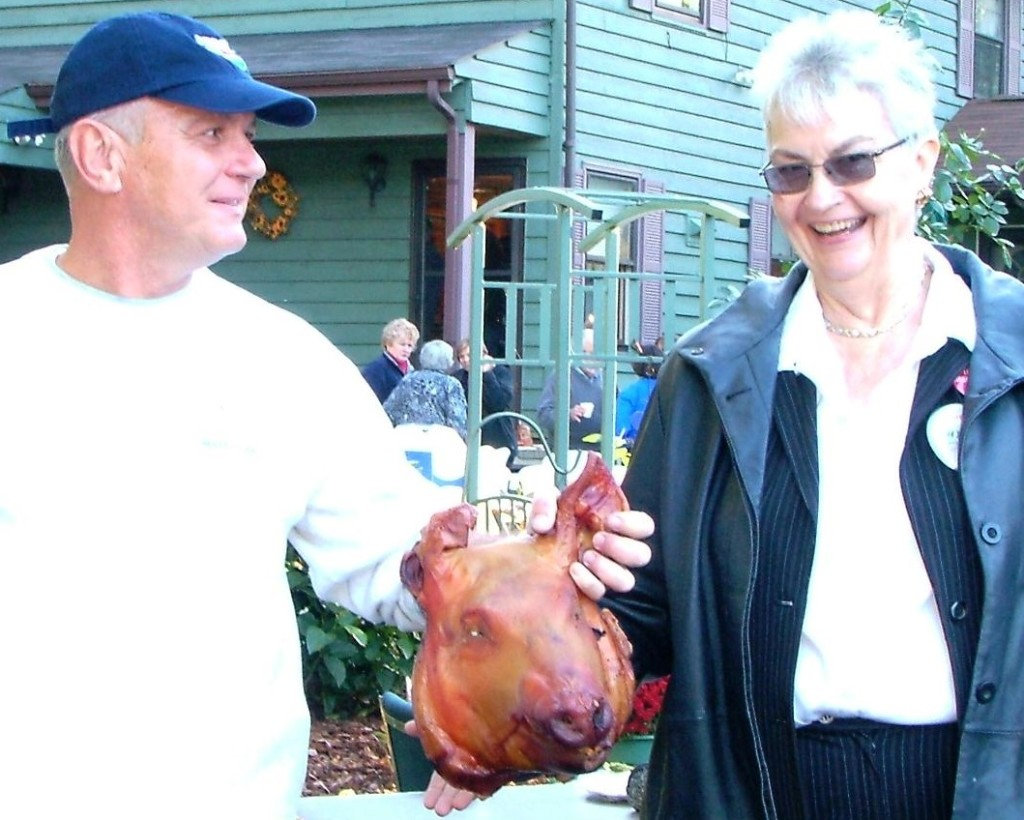Clare Whitbeck embraced all facets of politics in order to further her goals, including posing with pigs and politicians, such as her friend St. Mary's County Commissioner Dan Morris.  THE CHESAPEAKE TODAY photo