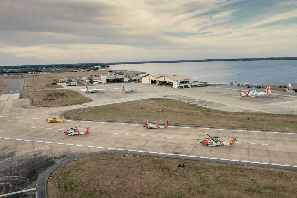 Coast Guard Dolphin Helicopter crews prepare to fly flight formations at the Wright Brothers National Memorial, Wednesday, March 10, 2016. Air Station Elizabeth City helicopter crews were at Kill Devil Hills to celebrate the centennial anniversary of the Coast Guard's aviation program with formation flights and a classic painting scheme. (U.S. Coast Guard photo illustration by Auxiliarist David Lau)