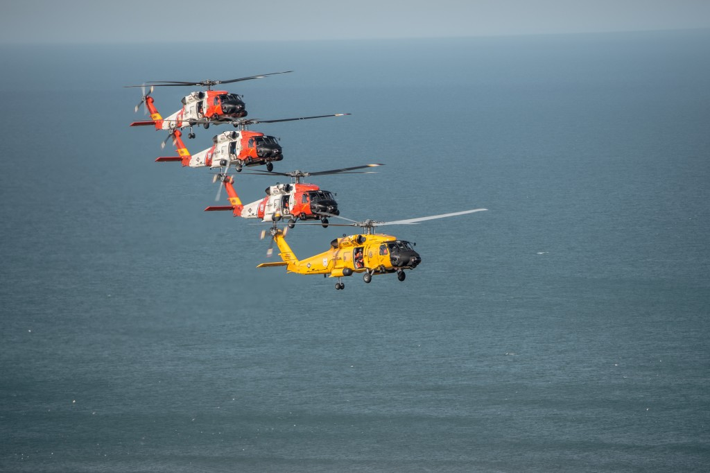 Coast Guard Dolphin helicopters fly flight formations at the Wright Brothers National Memorial, Wednesday, March 10, 2016. Air Station Elizabeth City helicopter crews were at Kill Devil Hills to celebrate the centennial anniversary of the Coast Guard's aviation program with formation flights and a classic painting scheme. (U.S. Coast Guard illustration by Auxiliarist David Lau)