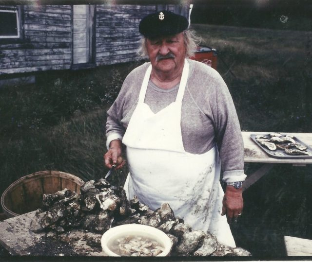 Pop Duffy at Duffy's Tavern in Scotland Md. on the Chesapeake Bay shucking oysters.