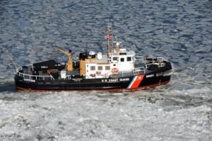 Coast Guard Cutter Capstan clears a path through ice on the Chesapeake Bay.  Coast Guard photo