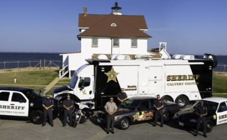 Calvert County Maryland Sheriff's Deputies gather round Cove Point Lighthouse on the Chesapeake Bay. Calvert County has about thirty miles of coast line on the Chesapeake.