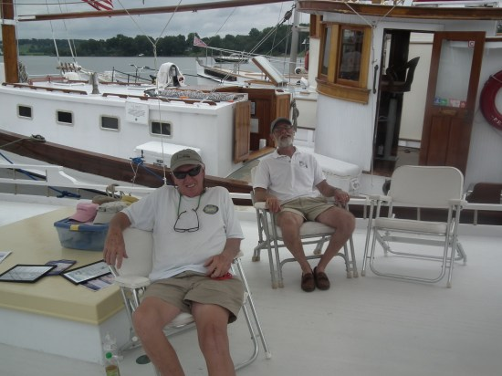 After a hard day sailing up the Potomac these captains prepare for explaining to visitors what a buyboat is and how they functioned. John England, at center, led the effort to save the F.D. Crockett, the oldest log boat in Virginia. THE CHESAPEAKE TODAY photo