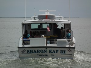 Sharon Kay heads for Tangier Island in warm weather. Now she will be escorted by the Maryland NRP cutter J. Millard Tawes cutting a path in the ice. THE CHESAPEAKE TODAY photo