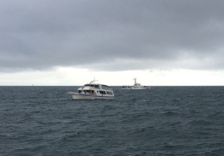 Coast Guard rescue of 3 people from sinking vessel off Cape Hatteras 110415