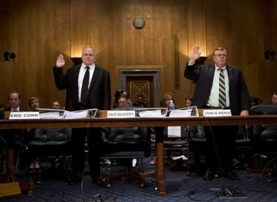 Attorney Eric Conn (left) and Social Security judge Charlie Andrus are sworn in during a Senate Homeland Security and Governmental Affairs committee hearing in 2013 on Capitol Hill. Andrus has pleaded guilty to a federal charge; prosecutors say he tried to retaliate against a whistle-blower in his agency. Credit: AP file photo