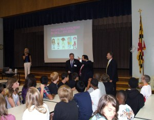 Students and school officials in a program at Spring Ridge Middle School.