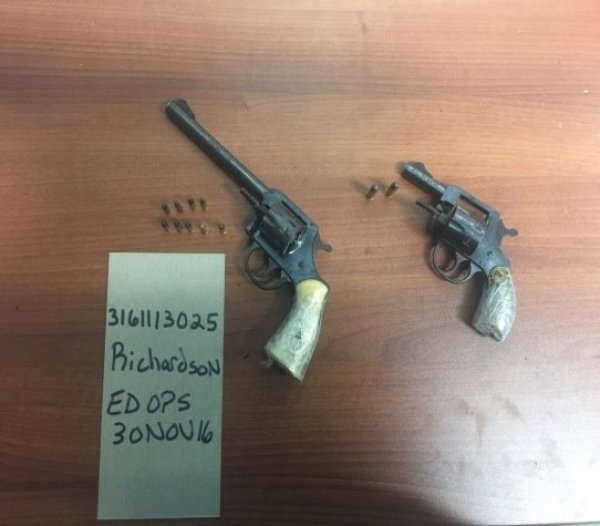 Guns nabbed along with two armed robbers by Baltimore Police.