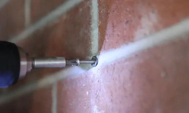 screw in brick wall