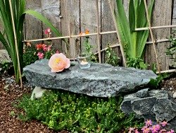 Outdoor stone altar with rose and candle