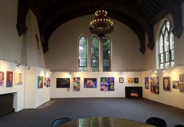 image of a gallery with multiple painted and drawn portraits of people