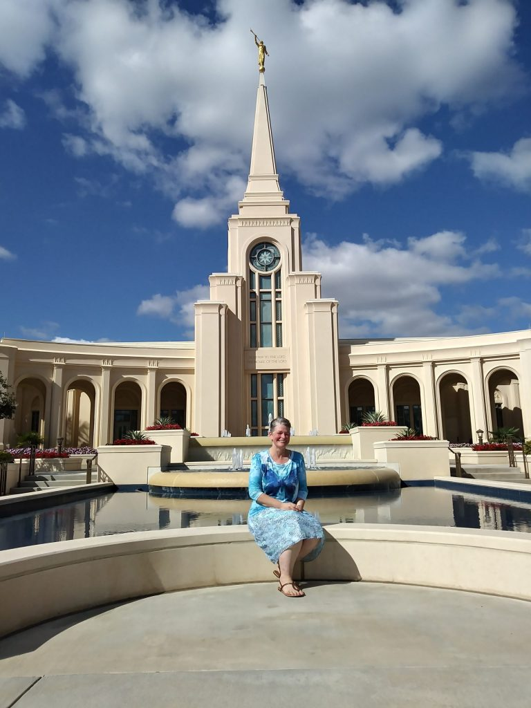 Maggie sitting by the Ft. Lauderdale Temple in Florida on a beautiful sunny day