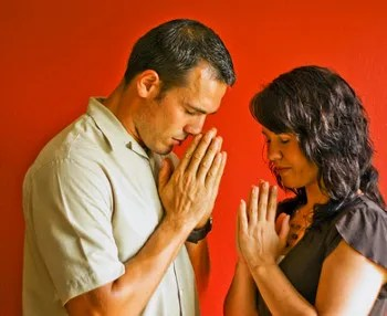 Couple praying as one © Mark Bojovic | Dreamstime.com