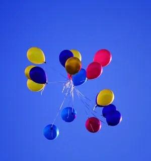 Released balloons © Vyacheslav Tyulin | Dreamstime.com