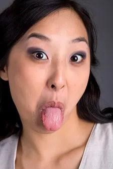 Woman sticking out tongue © Brad Rickerby | Dreamstime.com