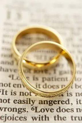 Wedding rings on Bible © Monkey Business Images | Dreamstime.com