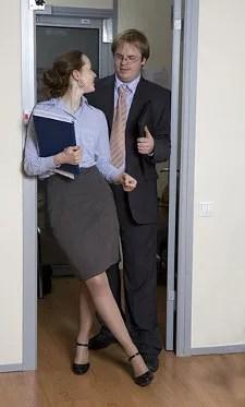 Office flirting © Elena Rostunova   Dreamstime.com